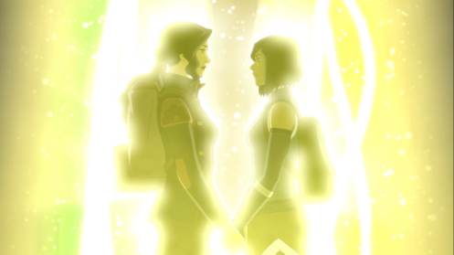 An image shows Korra and Asami facing each other in the glow of a spirit portal while holding hands.